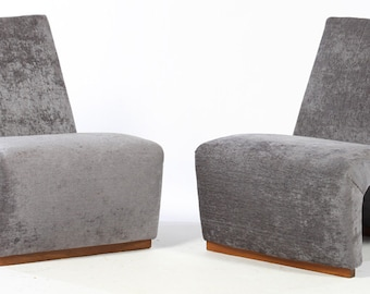 pair of Italian mid century modern slipper chairs having continuous back and seat circa 1970.