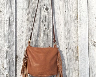 Leather purse with zipper, fringe and adjustable strap
