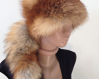 Women's cap of fox fur and leather. Removable tail.