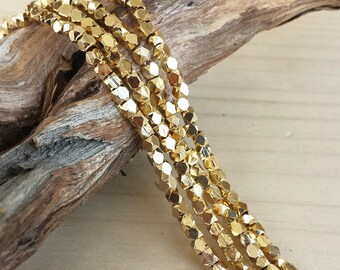 Gold - 2-2.5mm Faceted Metal Beads - Cornerless Cubes - Shiny Gold Plated Brass - Full or Half Strand (approx. 100 or 200 pcs)
