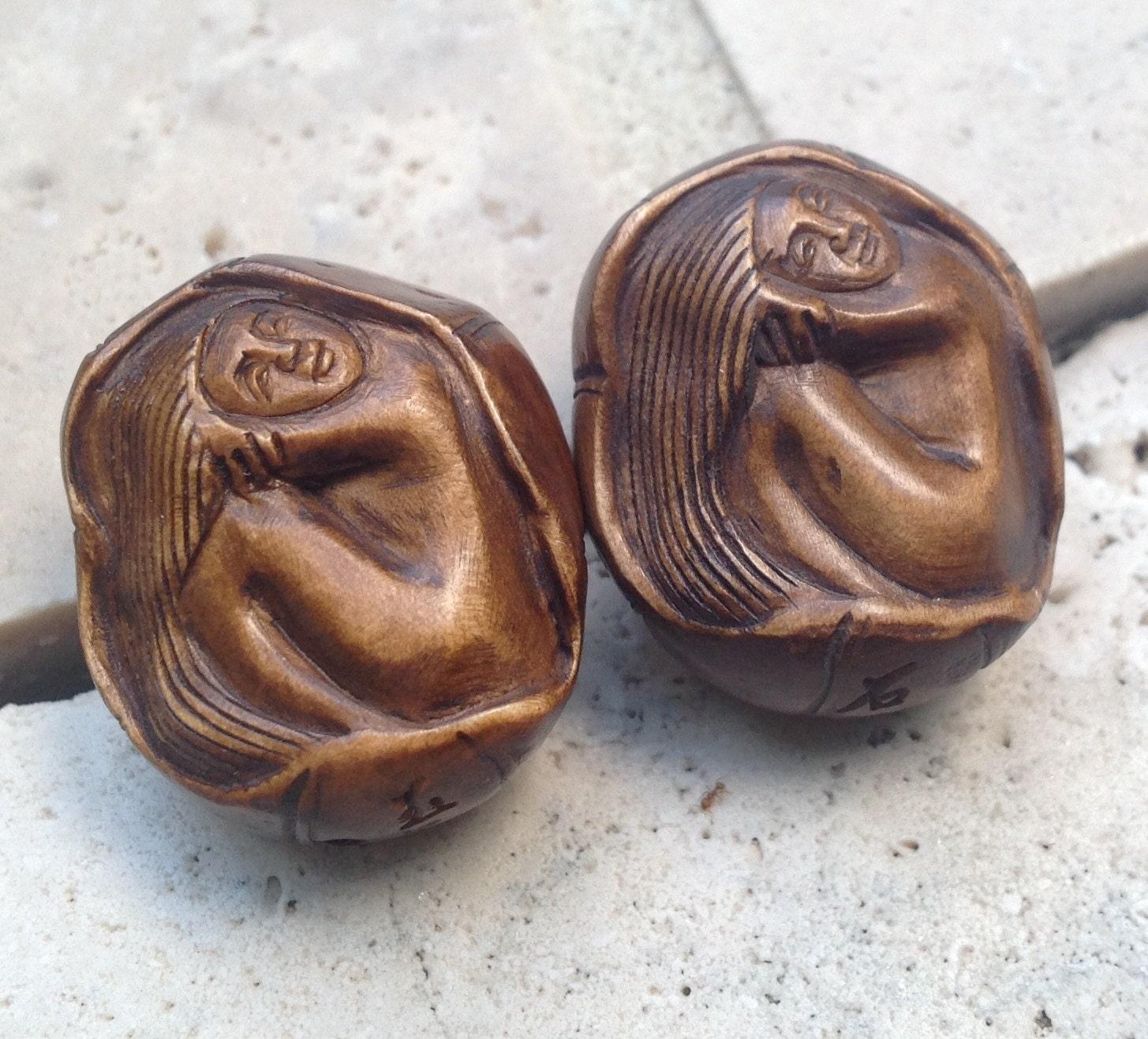 Hand carved boxwood ojime bead mermaid in a pumpkin shell