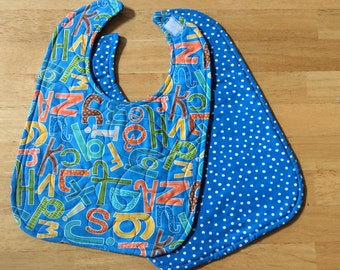 "Quilted baby/toddler bib - blue abc print, velcro closure, reversible, 10"" x 13 1/2"""