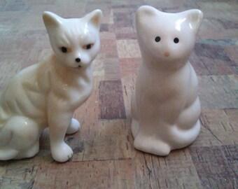 2 small white cat ornaments