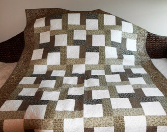 This rich chocolate brown and sage green throw is a marvelous accent piece for your home!