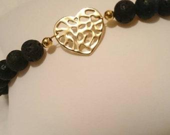 Lava bead bracelet, gold heart bracelet, black and gold bracelet, healing stone jewellery, lava stones, heart charm bracelet, natural stone
