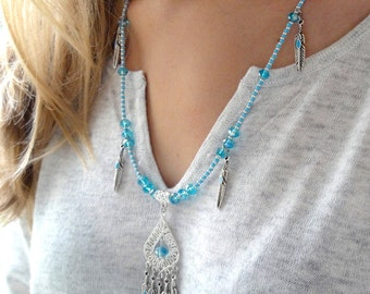 Medium-long necklace with silver feathers and turquoise Crystal