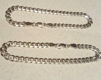 2 solid sterling silver link bracelets.