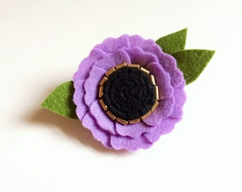 Felt flower alligator clip or headband - lavender prple poppy with gold and black center and green leaves
