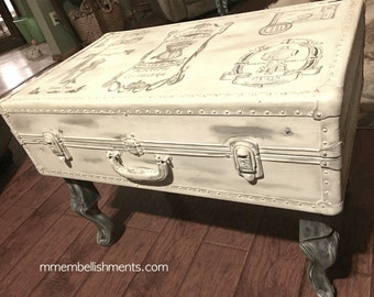 Steamer trunk / vintage luggage turned French~inspired coffee table with Queen Ann legs