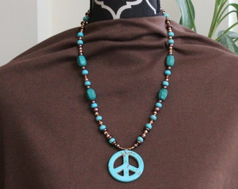 "Peace be with you.  Peace sign beaded pendant necklace.  12.5"" L"