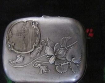 silver metal cigarette case, mont-st-michel, france