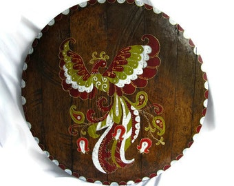 Round wooden panels, decorated with hand-painted