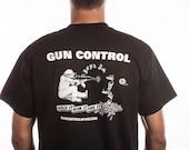 Guncontrol Hold It Aim It Fire It Man Sitting T Shirt
