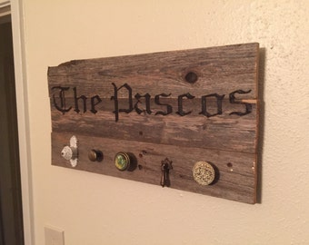 Custom name engraved coat rack/wall decor made from reclaimed wood.