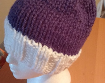 Blue and white hat with pompom
