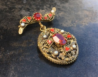 Vintage Bohemian red rhinestone medal brooch, clear, opaque and opaline glass stones