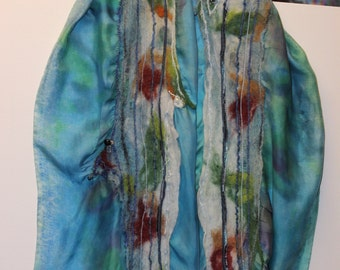 Wet felted then attached to hand painted silk scarf