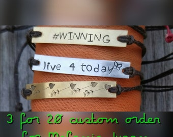 Custom hand stamped bracelet with waxed leather cord