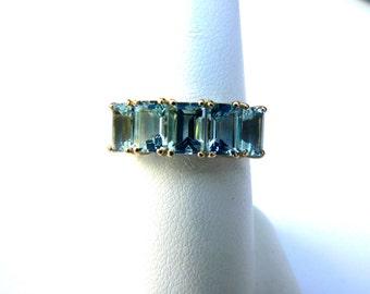 Crystal Clear Aquamarine 14K Yellow Gold Band Emerald Cut Stones
