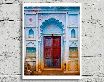 Fine Art Print, Weathered Red Door in Faded Blue Stucco wall, Orcha, India