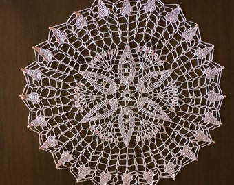 Pink beaded doily