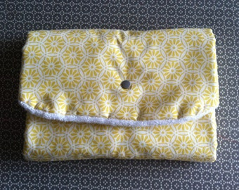 Changing customizable travel mat. Portable mattress. Sponge white and fancy yellow and white cotton. for baby