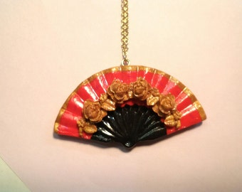 Reddish hand fan necklace from polymer clay