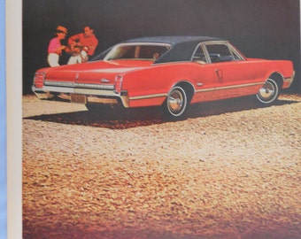 "1966 Oldsmobile Cutlass Ad.  1966 Olds Cutlass 2 door sports coupe ad.  Full color.  10'x 14"".  Life Magazine.  Feb 18, 1966."