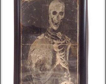 Creepy Victorian skeleton aged print in frame.