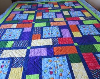 Bugs Laptop quilt with flannel back. Primary colors and a flannel back featuring the alphabet.  FREE
