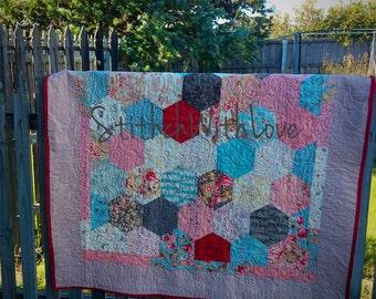 Patchwork quilt featuring Moda Papillon fabrics