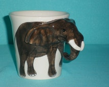 Ceramic mug shaped elephant. 3D elephant mug. For funny breakfast.