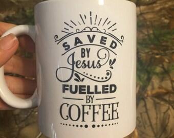 "11 oz Coffee Mug ""Saved by Jesus Fueled by Coffee"" British English"
