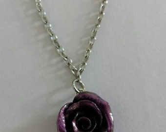 Deep purple rose necklace with pearl accents.