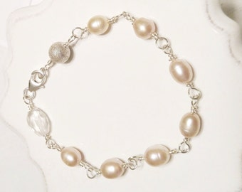 Sterling silver bracelet with champagne freshwater pearls, aquamarine, and sterling bead
