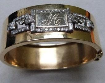 14 karat yellow gold hinged bangle bracelet