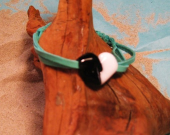 Black and white lampwork heart bracelet on braided turquoise leather