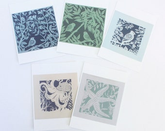 Set of 5 postcards printed with papercut bird and octopus designs