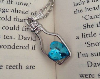 Blue heart inside bottle shaped pendant necklace