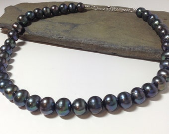 Stunning black freshwater cultured pearl necklace.