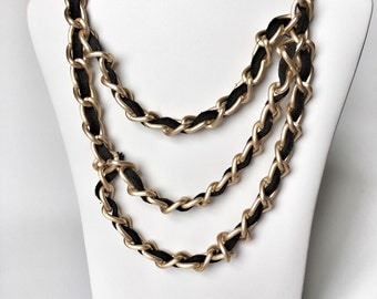 Asymmetrical black and gold chain necklace