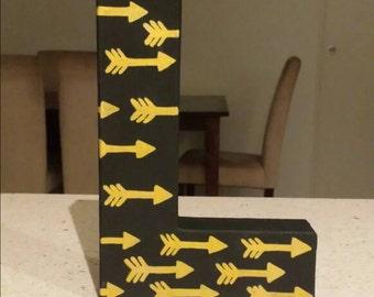 Customized letter golden arrows