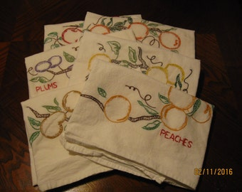 A set of 6 hand embroidered flour sack dish towels.