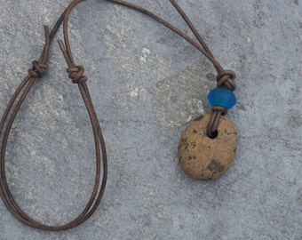 Adjustable brown beach pebble necklace with blue sea glass and leather cord