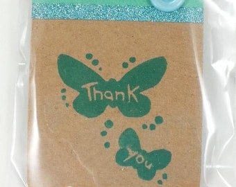 carved thank you Stempel with butterflies for scrapbooking, card making and decorating
