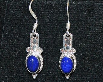 Silver earrings with lapis settings