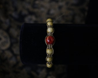 Handmade brown bracelet with red bead 001