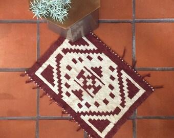 "Woven Navajo style textile in geometric tribal design // 20"" x 28"""