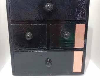 Set of four drawers with leather and copper accents in black