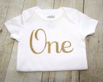 first birthday shirt - one year old baby girl glitter bodysuit - gold glitter 1st birthday shirt - one baby shirt - first birthday - One